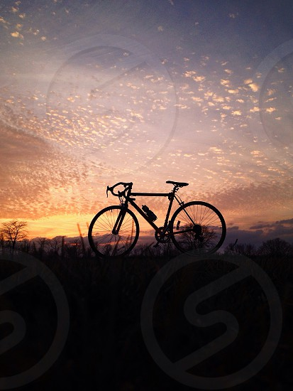 bicycle silhouette on sunset photo