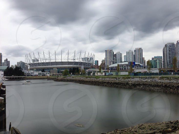 white stadium by the river photo