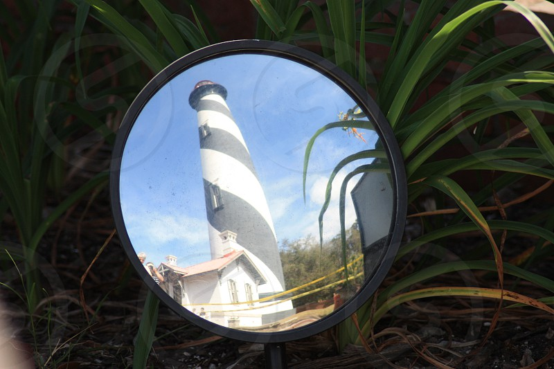 grey and white light house reflection  photo