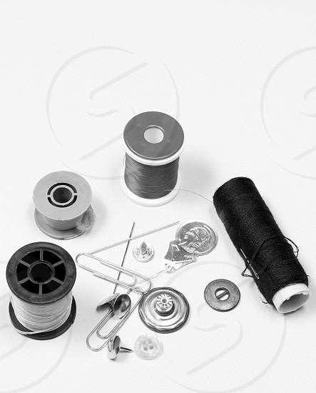 sew; thread; needle; tailor; sewing; clothing; button; white; textile; fashion; isolated; needlework; craft; background; object; design; red; cotton; repair; closeup; fabric; work; dressmaking; tool; colorful; embroidery; stitch; color; detail; industry; green; spool; yellow; clothes; string; hobby; cloth; metal; needlecraft; macro; bobbin; bright; seamstress; plastic; fix; texture; pattern; material; reel; leisure photo