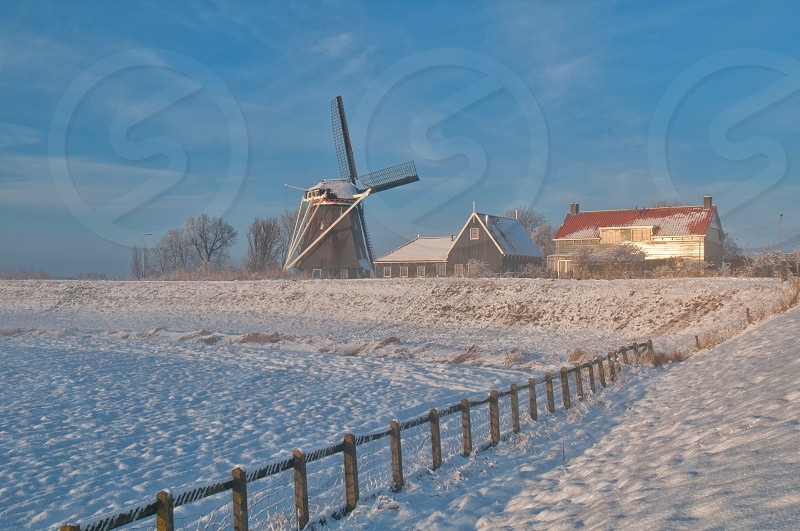 wind mill on winter view photo