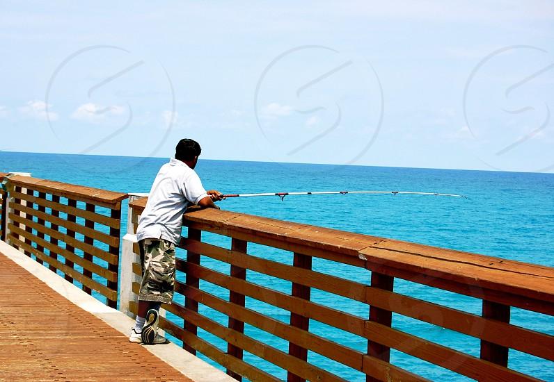 Man fishing on pier - Jupiter Florida (USA) photo