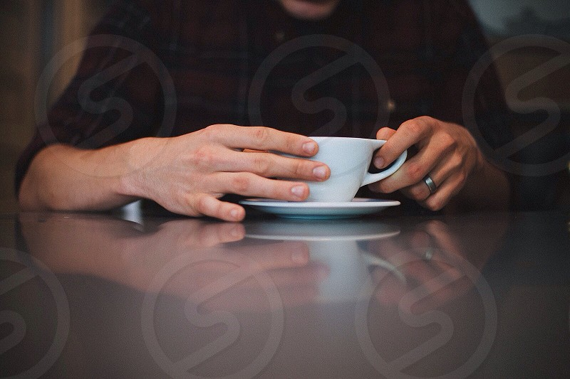 Hands in cafe photo