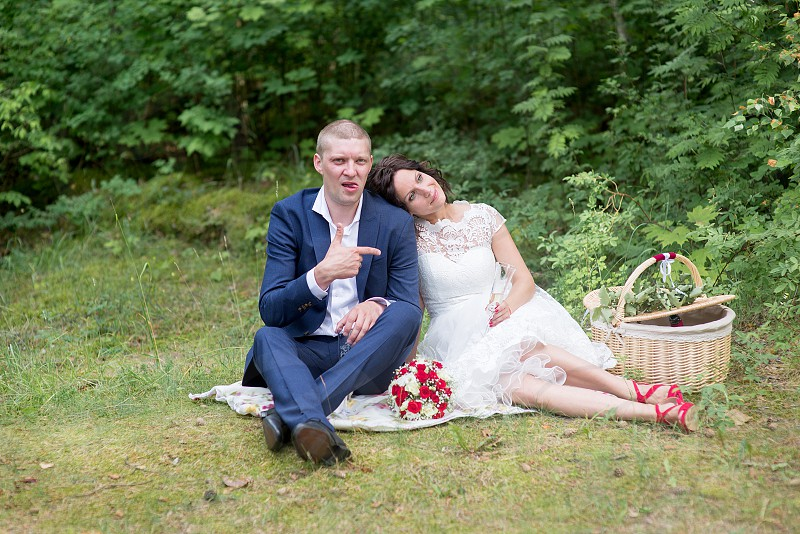Beautiful wedding couple is enjoying wedding photo