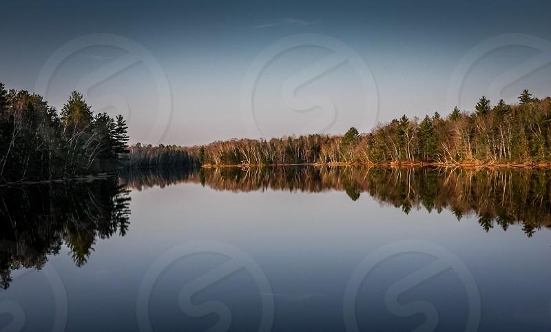 Inland lake at sunrise; northern US. photo