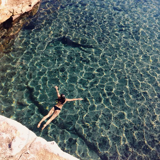 woman swimming on sea water in a sunny day photo photo