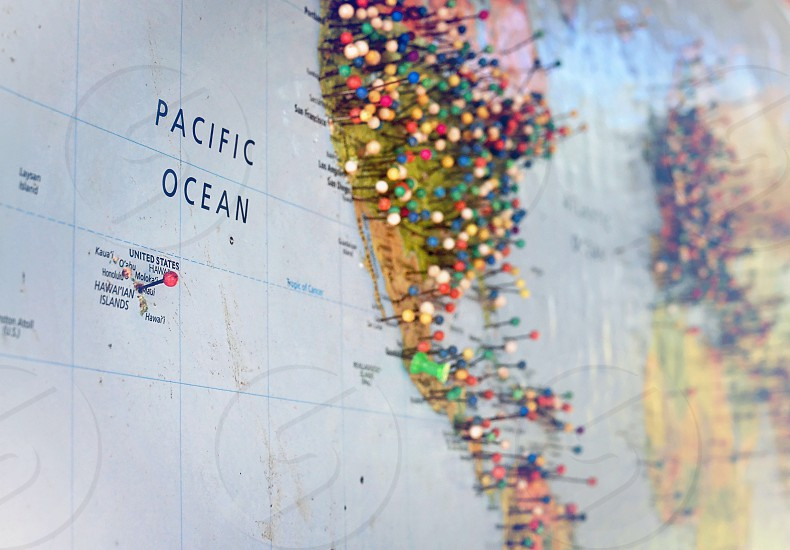 Deciding where to go by looking at a push pin-covered map photo