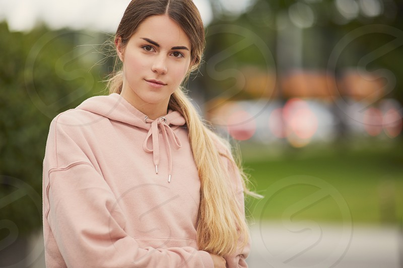 Pretty girl stand on the city street wear sport clothes photo