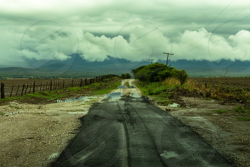 rural trail fall cluodly cordoba argentina lanscape mountains fog cloudly humidity tree line fence wire field  photo