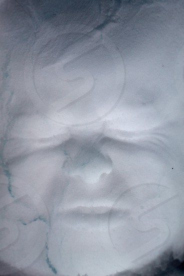 face imprint in the snow photo