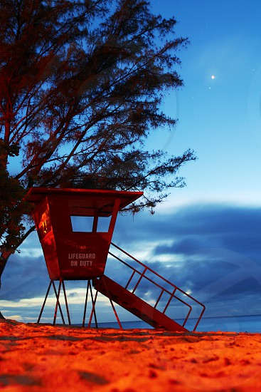 The old lifeguard stand at Rock Piles Beach on the North Shore Oahu Hawaii. photo