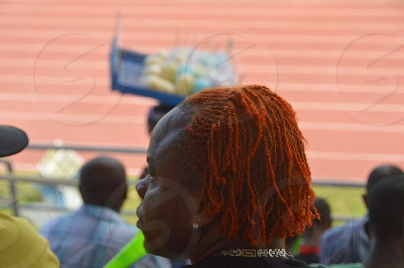 Stylish redheaded male watching the relays. photo