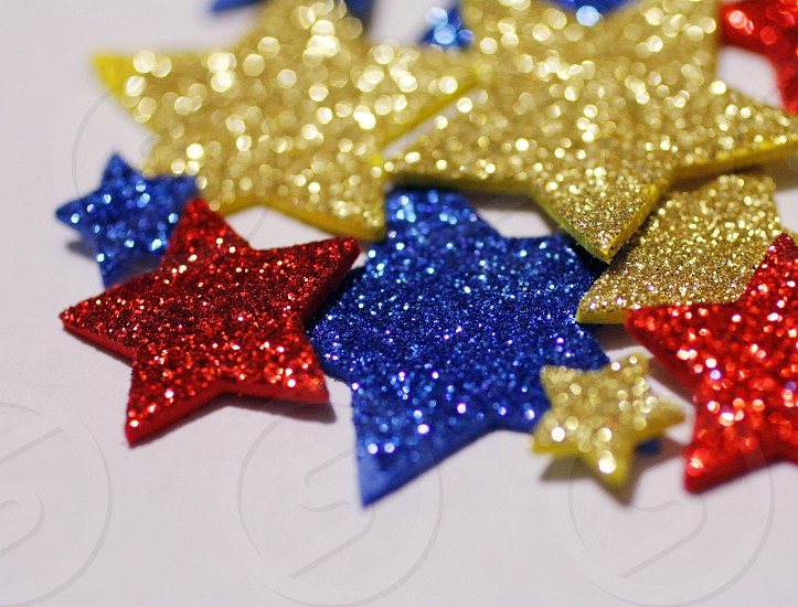 stars glittering stars red stars blue stars yellow stars photo
