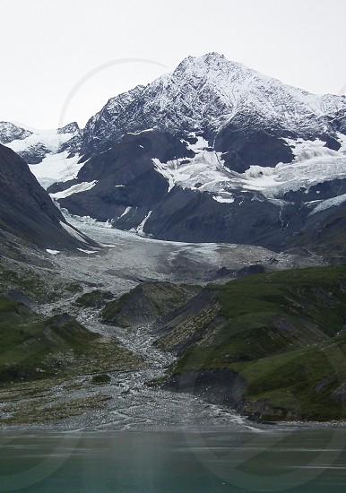 view of mountain range with snow caps photo