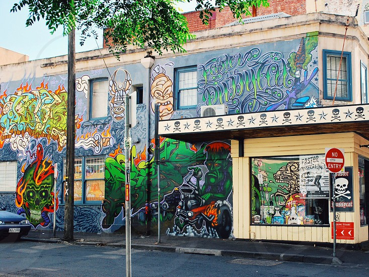 blue and green graffiti wall photo