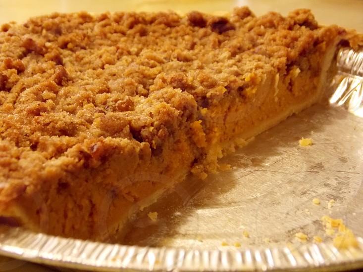 brown sliced pie on aluminum pan in tilt shift lens photo