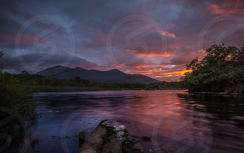 mountain and river over sunset view photo