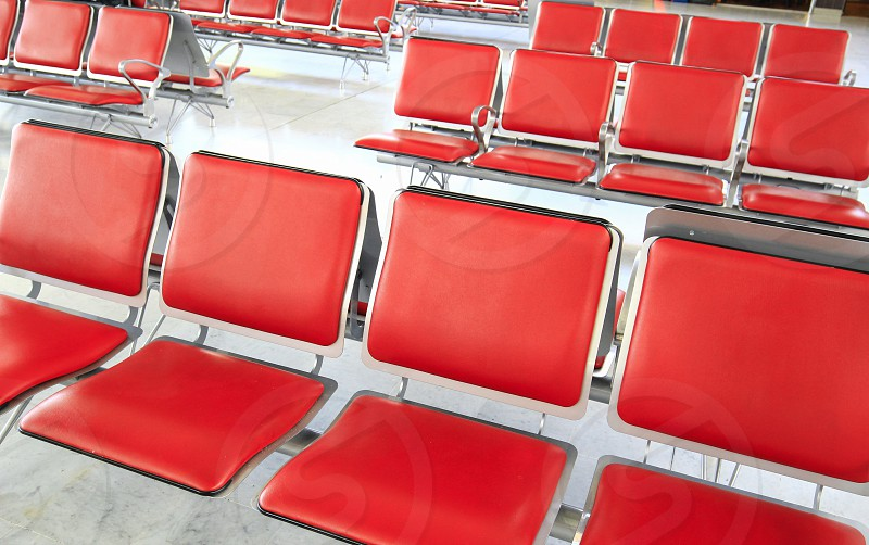 an airport waiting room chairs. photo