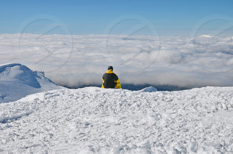 Lost man attending the view from the top of the mountain photo