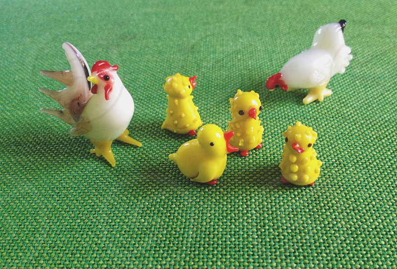 white rooster and yellow chick figure photo