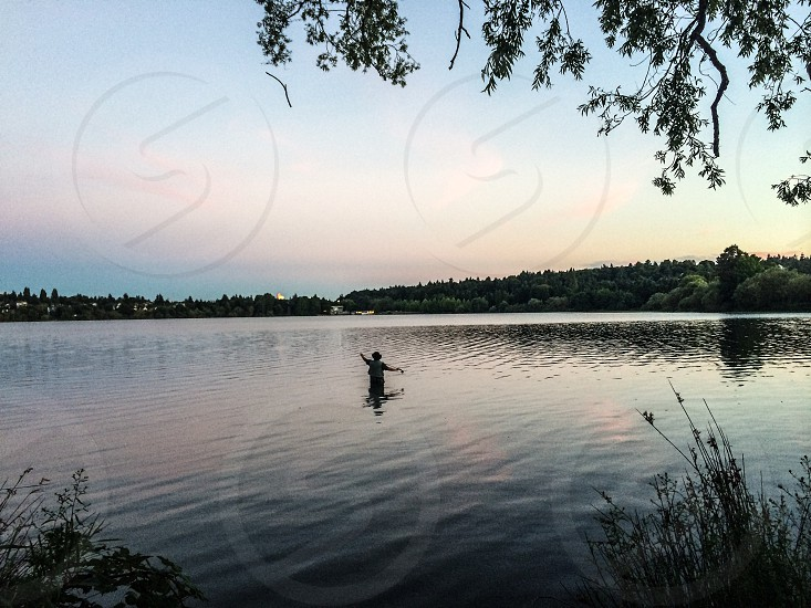 Fly fisherman Green Lake Seattle wa photo
