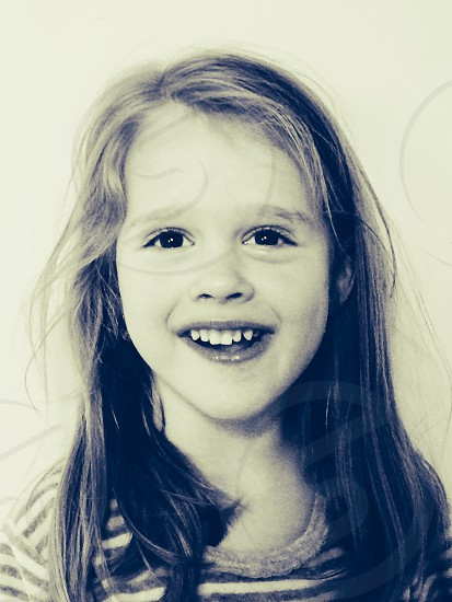 This is my daughter. Her smile her eyes tells what true love freedom and happiness is. Spontaneous morning shot but tells the whole story:) photo