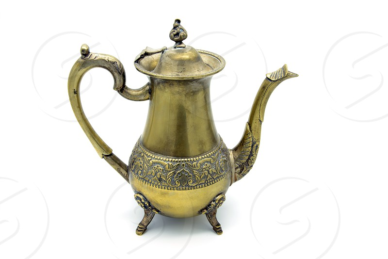antique metal coffee pot on white isolated background. photo