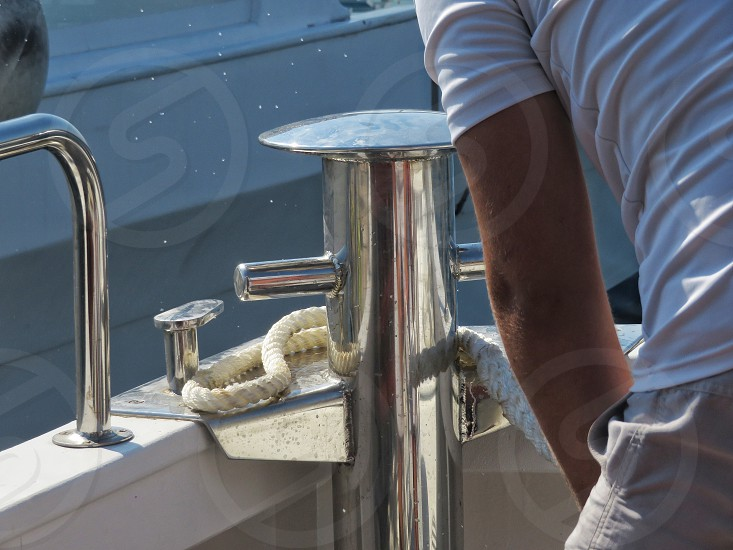 Sailor making a marine knot in the boat photo