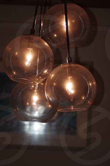 four clear glass shade lamps photo