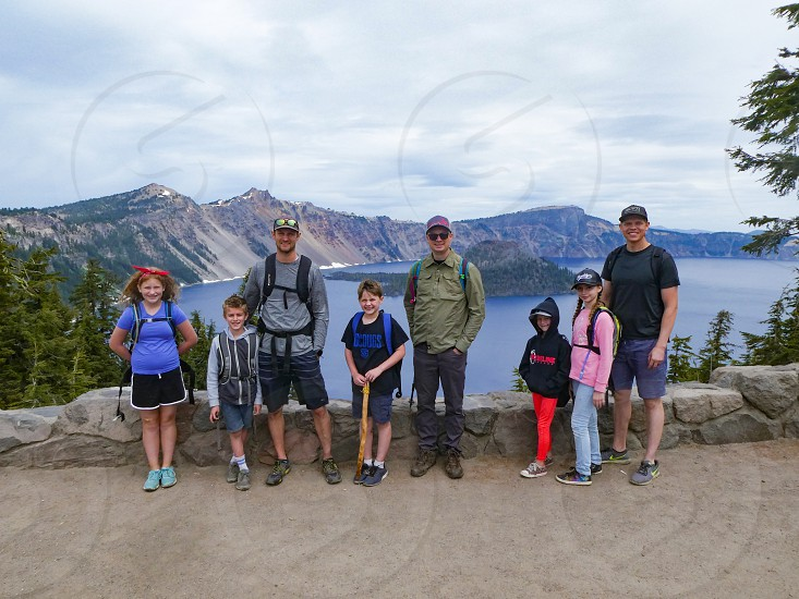 Family portrait on the edge of Crater Lake. photo