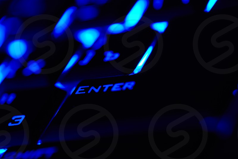 Enter key in a blue light. Macro shot. Shallow depth of field. photo