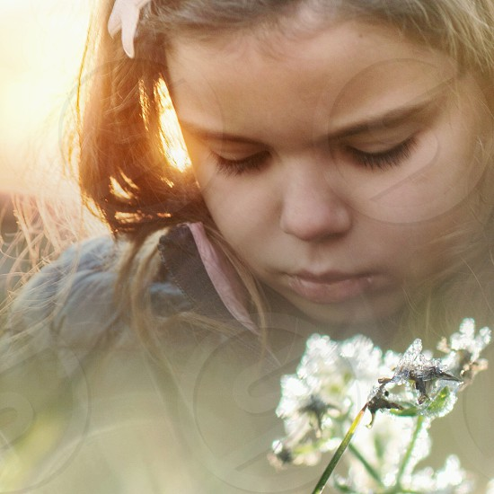 girl in gray shirt with background of sunlight in closeup photography photo