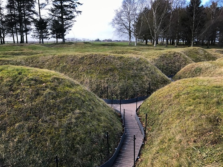 Outdoor day landscape horizontal colour Beaumont Hamel France Somme western front Battle site battleground historic historical remembrance commemoration respect WWI WW1 World War One First World War Memorial blue sky War warfare battle Trenches trench path pathway forces army history photo