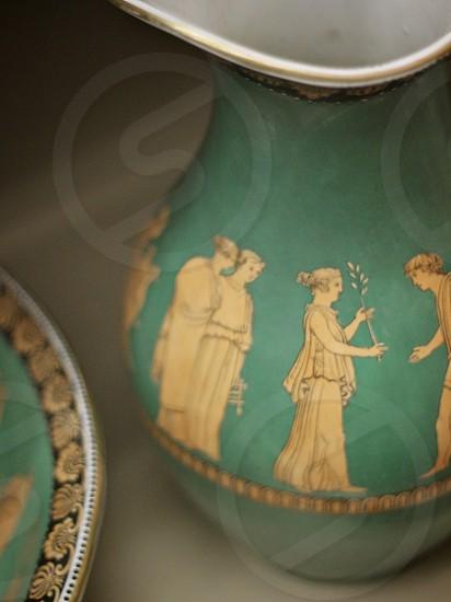 pottery vessel urn pitcher teal green figures greek roman design artifact photo