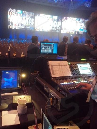 A sound engineer mixes music on a mixer. photo
