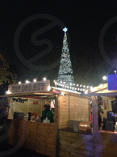 brown wooden store near Christmas tree photo