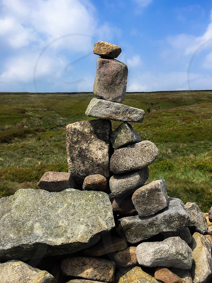 Balancing stones on hill walk Lancashire uk  photo