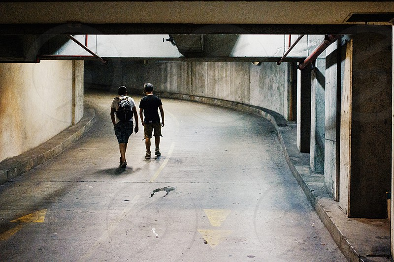 Two young men walk home in Sydney city near midnight. photo