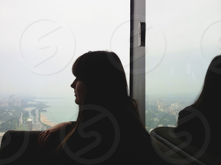 woman looking out window photo