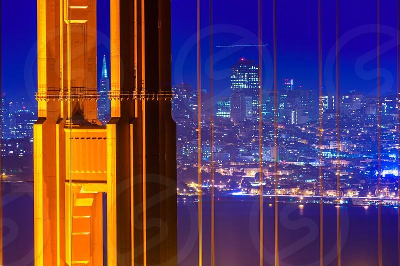 San Francisco Golden Gate Bridge sunset view through cables in California USA photo