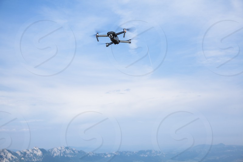 Drone flying over mountain photo