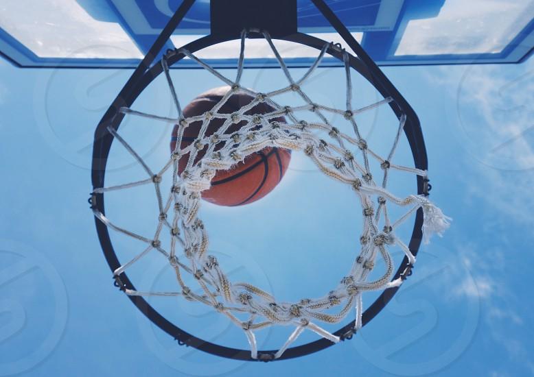 Basketball shot closeup of ball and net photo