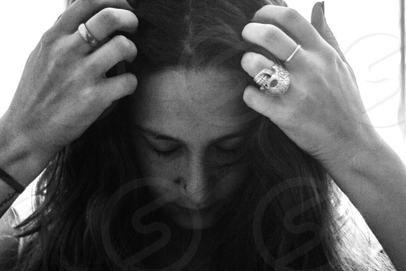 woman holding hair photo
