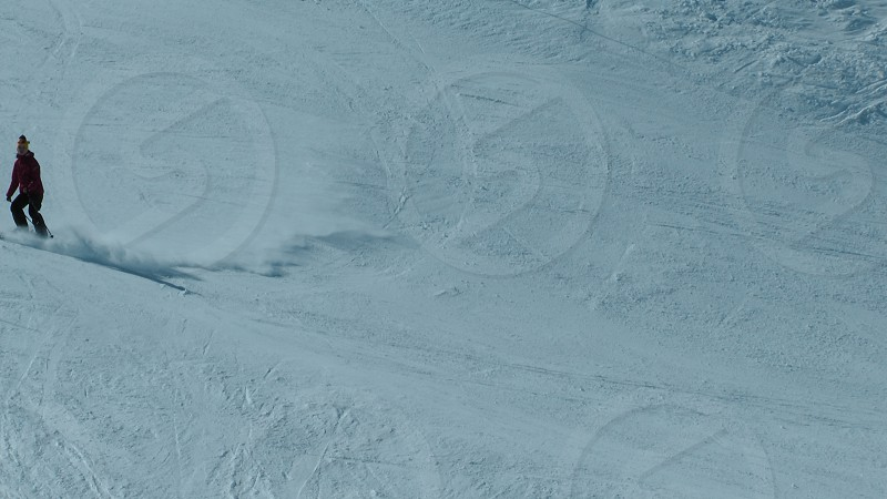Skiing across the piste photo