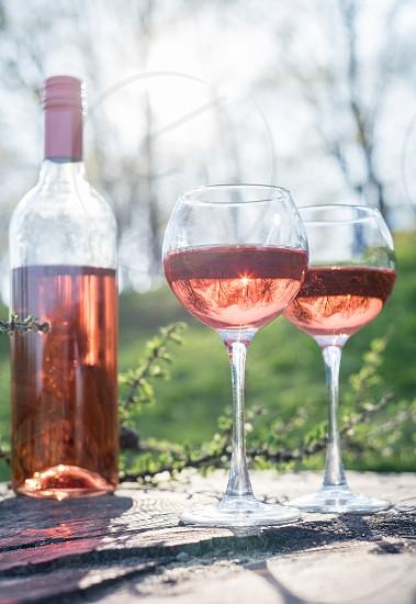 pink wine outdoors shot photo