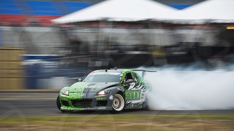 green and black Mazda RX-8 drifting photo