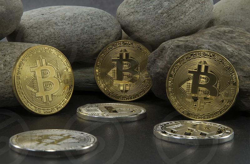 strong bitcoins golden coins  solid as a rock photo