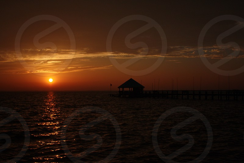 brown dock house silhouette photo