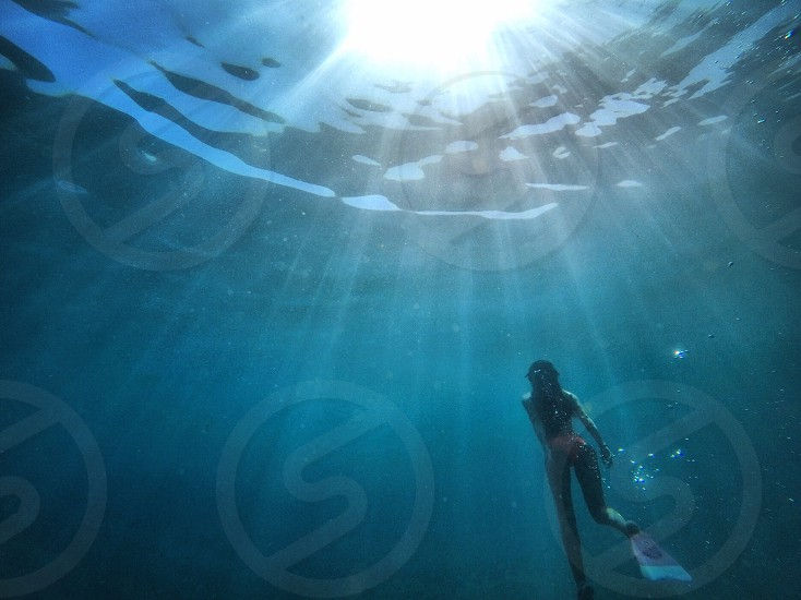 Swim float underwater chill be surrender summer light sunlight nature natural lights reflections ocean sea water peaceful  photo
