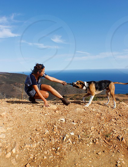 Tug of war dog animal girl woman fit legs workout view landscape strong photo